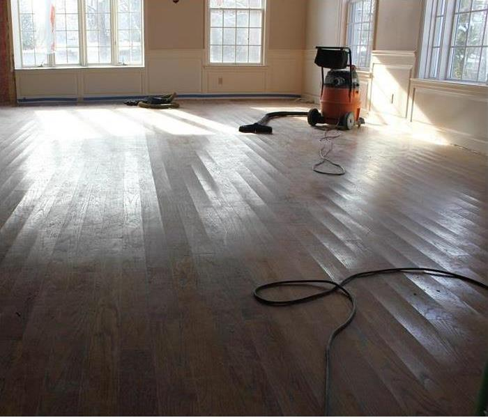 heavy duty vac, slight cupped floorboards, clean room now