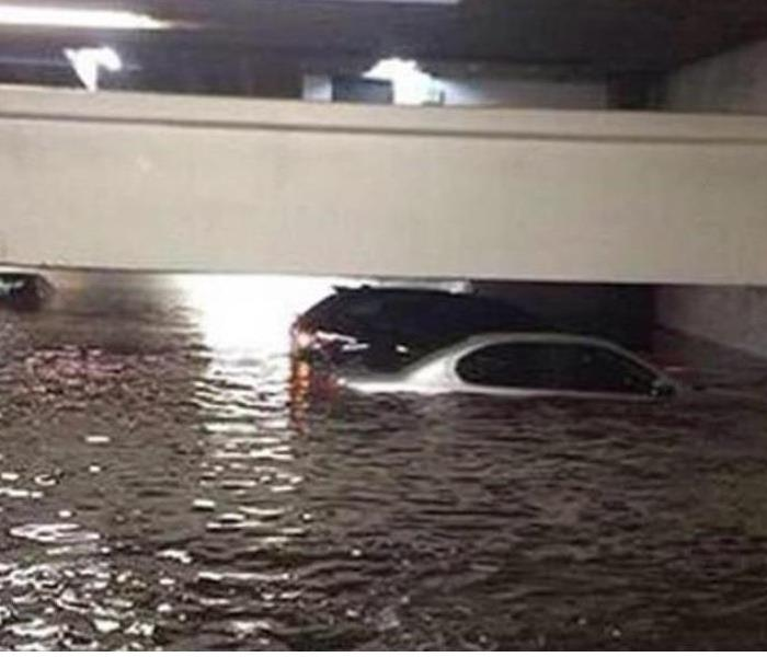 Storm Damage Building Pop Up Parking Garages to avoid Storm Water