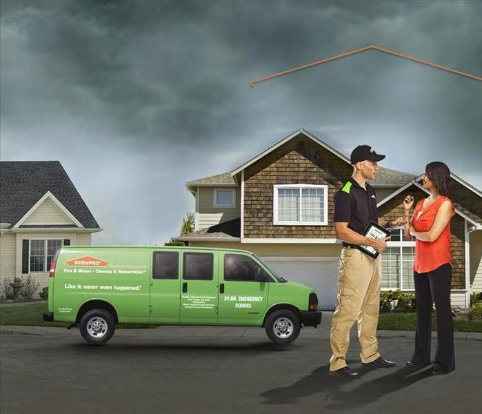 SERVPRO technician consulting with customer